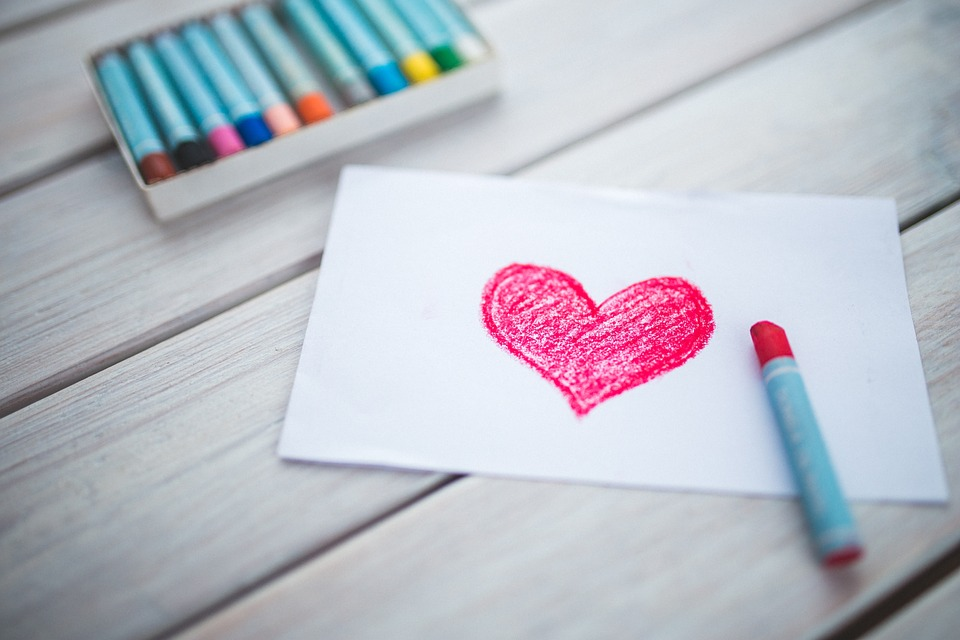 writing characters from the inside out photo - heart with crayons